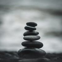 stacked_river_stones_theupperhanddayspa